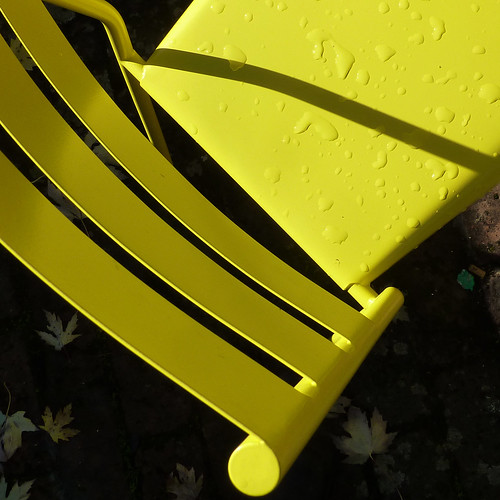 wet yellow chair by pho-Tony
