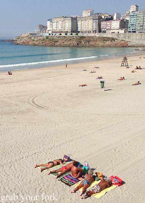 Sunbakers on Orzan Beach in A Coruna, Galicia, Spain