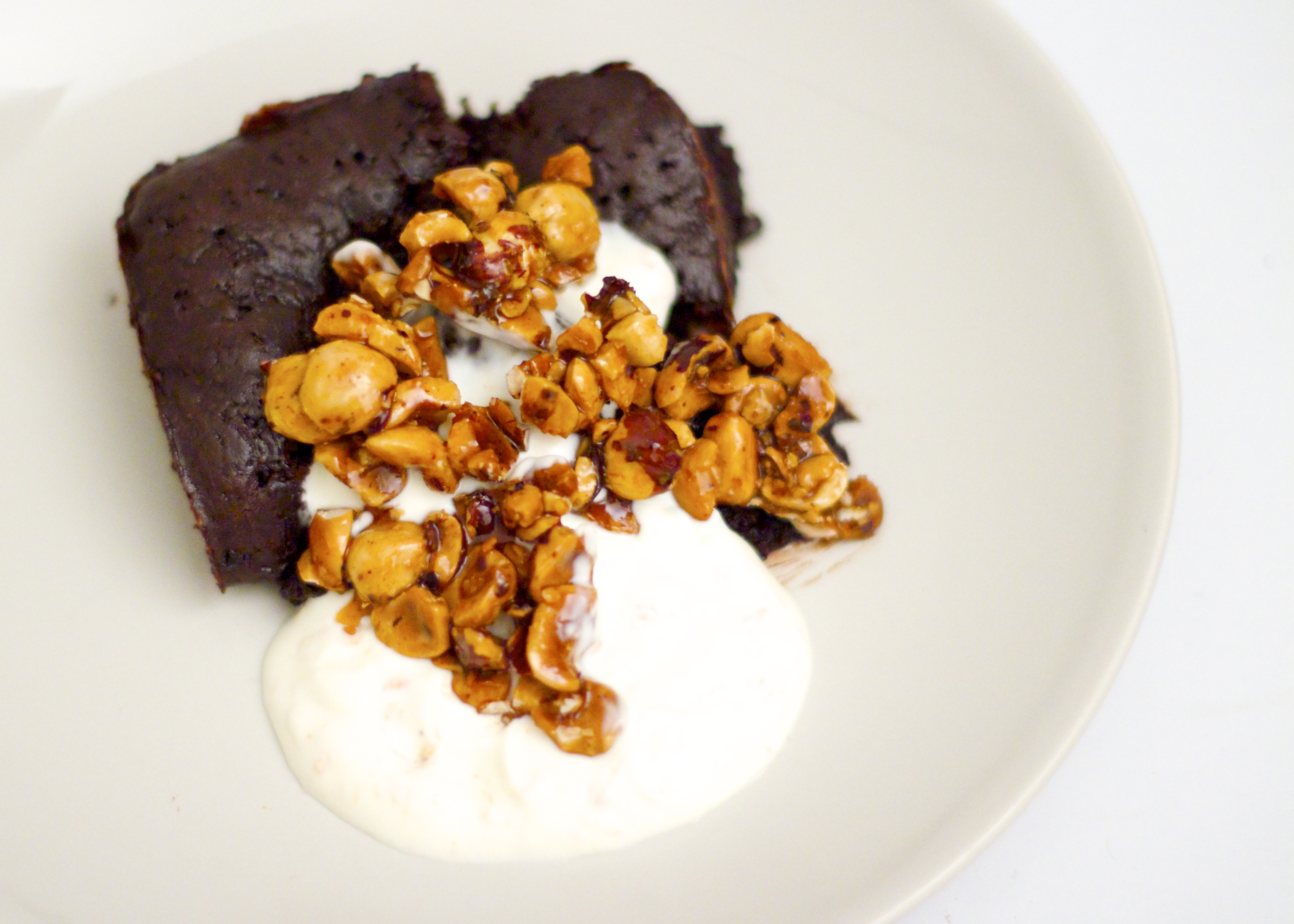 Nopi's Chocolate Cardamom Cake with Spiced Candied Hazelnuts & Orange Crème Fraîche