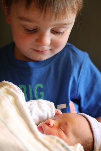 Holding His Little Brother For The First time