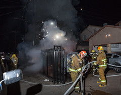 Car Fire in South L.A. Alley Threatens Homes