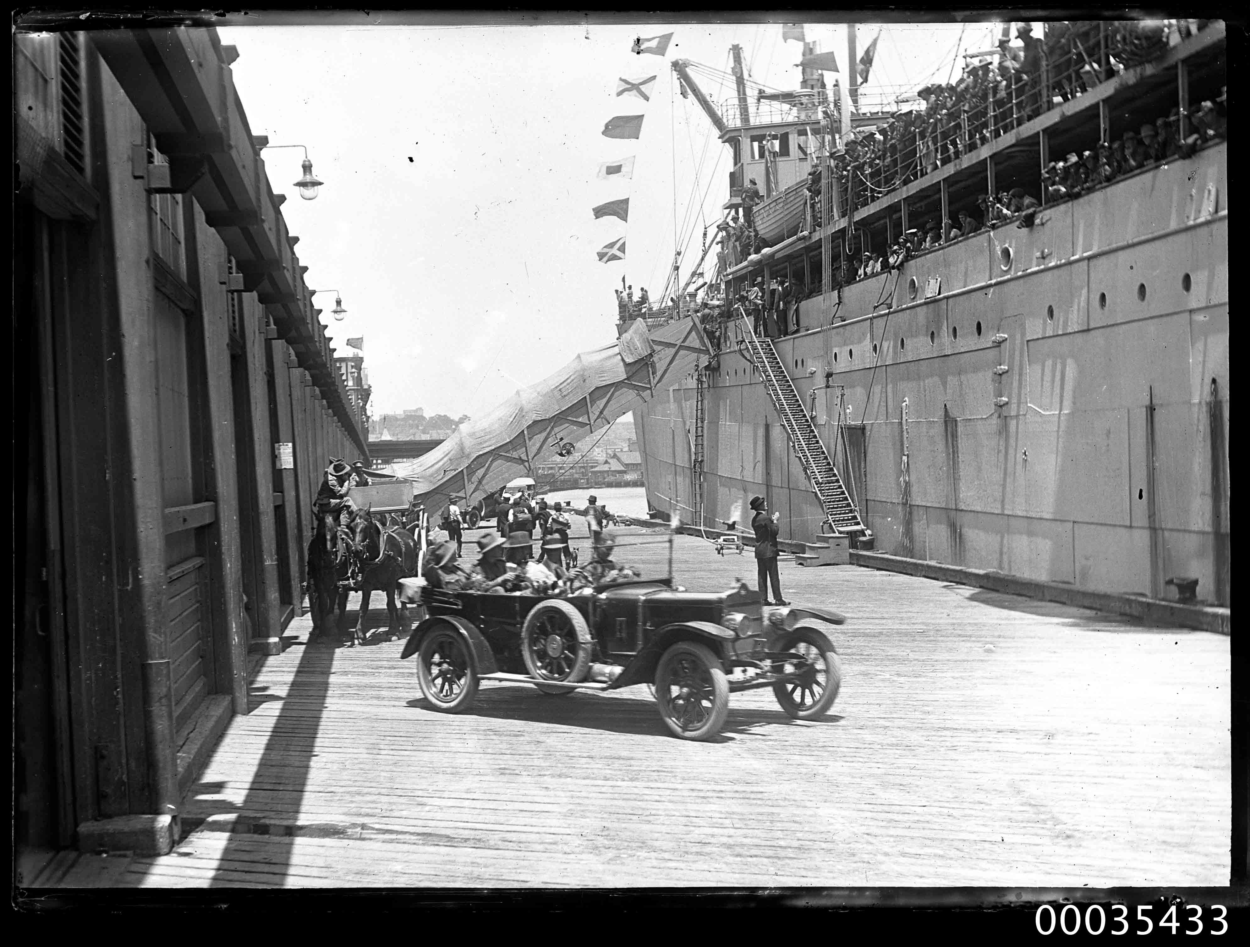 Partial view of a passenger ship docked at a wharf possibly in Sydney