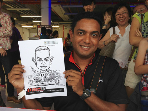caricature live sketching for NTUC U Grand Prix Experience 2013 - 14