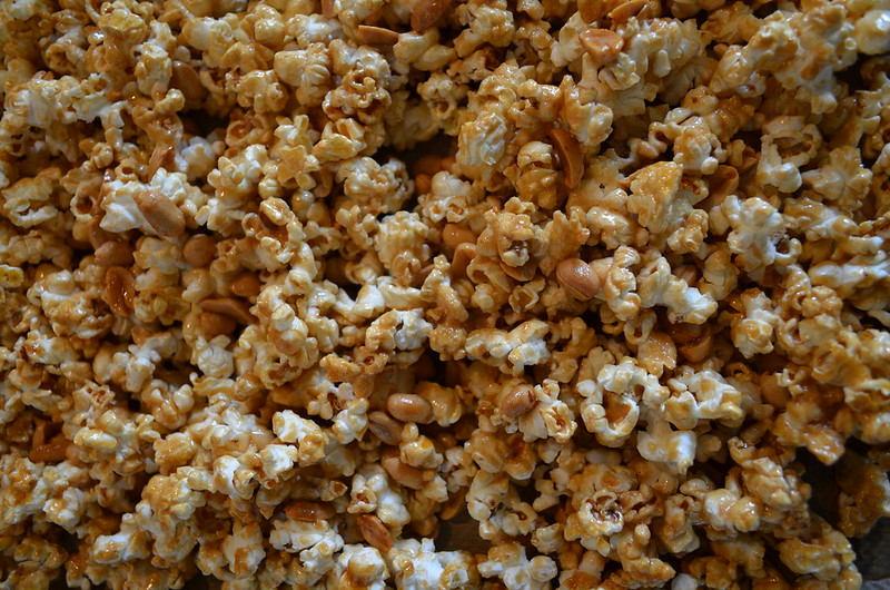 Salted caramel bourbon popcorn with peanuts close-up