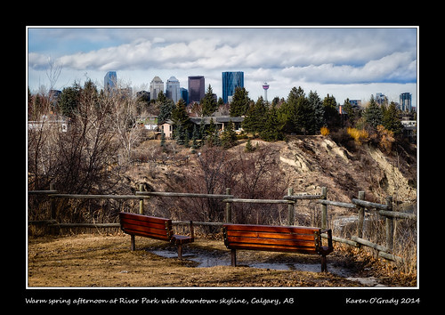 Happy Bench Monday - Warm spring afternoon at River Park with downtown skyline, Calgary, Alberta