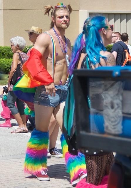 Shirtless guy in rainbow legies