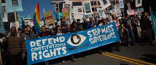 Protesters march through downtown Washington, D.C. during the Stop Watching Us demonstration on October 26, 2013. by Pan-African News Wire File Photos