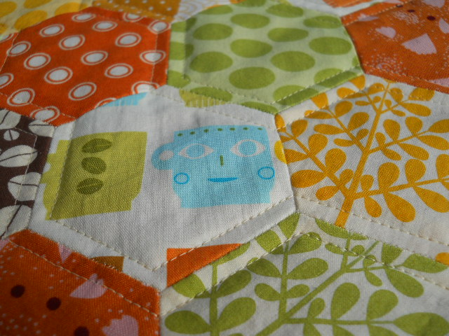 detail, quilting over hexies