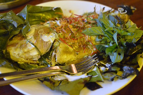 Whole fish, grilled in banana leaf, green curry paste, Thai basil