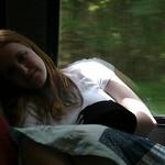 Sarah sleeping on a bus