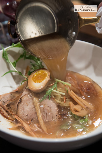 Shoyu pork broth into our ramen