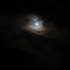 supermoon behind the stormclouds