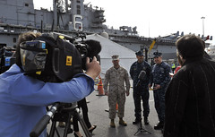 Australian media interview Colonel John E. Merna, commanding officer of the 31st Marine Expeditionary Unit; Capt. Cathal O'Connor, the commander of Amphibious Squadron (PHIBRON) 11; and Capt. Daniel Dusek, commanding officer of the amphibious assault ship USS Bonhomme Richard (LHD 6) following the ship's arrival in Brisbane for a port visit, July 9. (U.S. Navy photo by Mass Communication Specialist 2nd Matthew Dickinson)