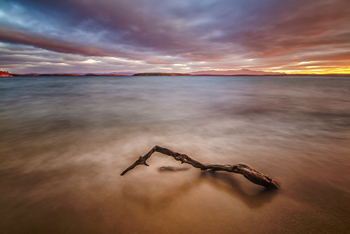 longexposure sky lake beach water sunrise newhampshire driftwood gilford lakewinnipesaukee robertallanclifford