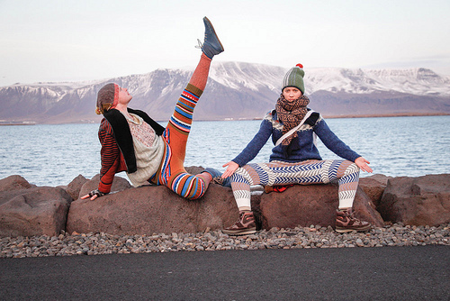two people wearing swants and striking poses