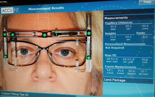 Bionic woman, photographer. We can rebuild her. We have the technology. We can make her better than she was. Better...faster...stronger. Accufit, glasses measurement contraption, Lenscrafters, Northgate Mall, Seattle, washington, USA by Wonderlane