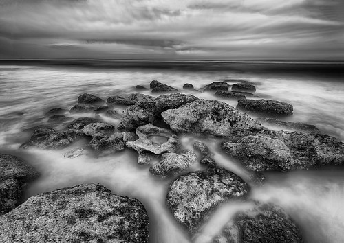 ocean longexposure sky blackandwhite bw usa cloud white black water rock landscape lowlight florida nighttime marineland centralflorida palmcoast