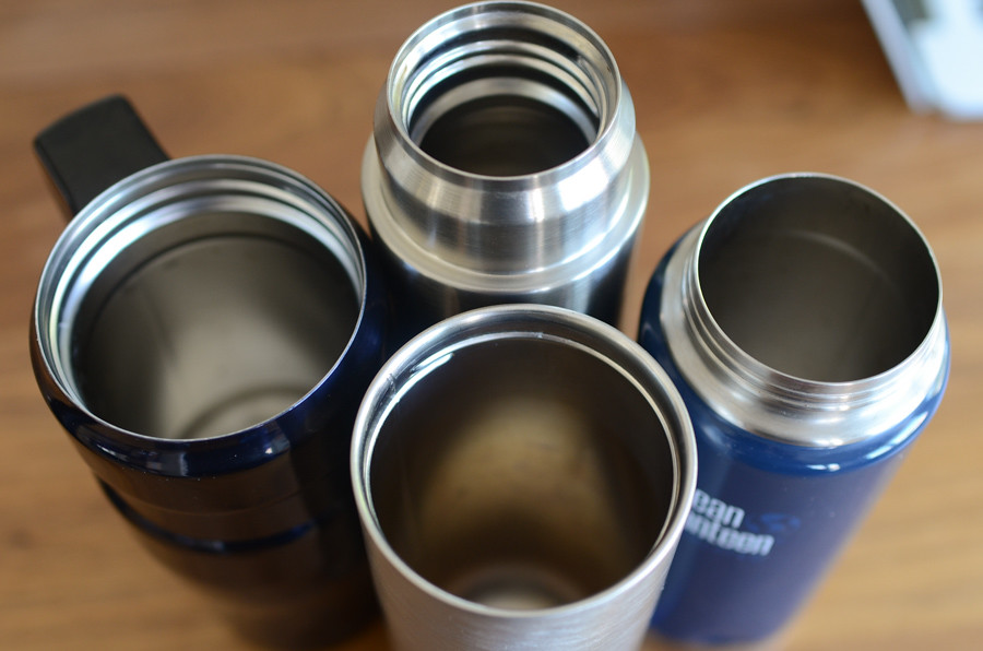 stainless steel metal mugs on table