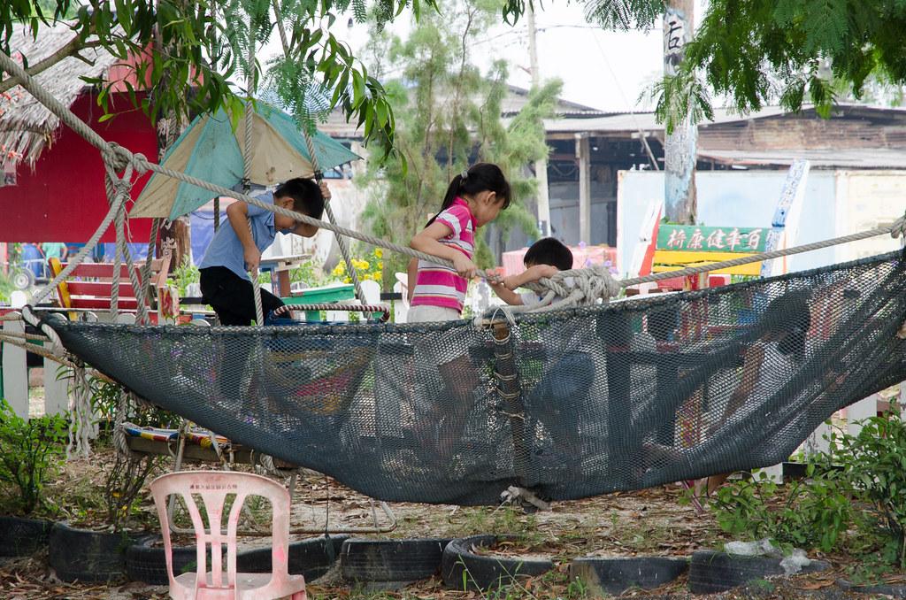 Happy kids playing at the Pantai Redang Beach, Sekinchan