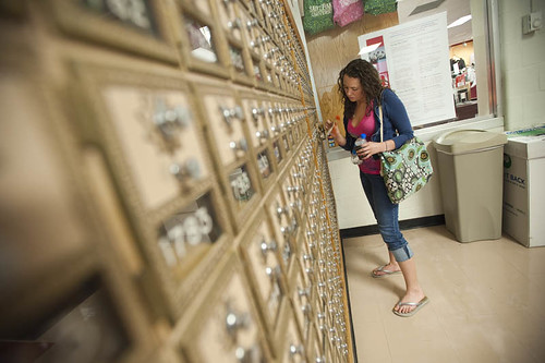 Student at campus mailbox
