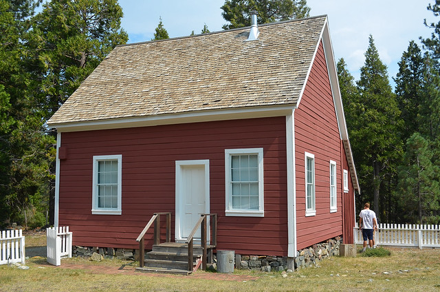 Moriarity House - a small red house with a white door.