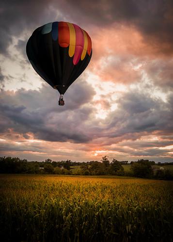trees sunset summer sky sun black field clouds rural landscape evening corn ride farm balloon stormy late hotairballoons paintedlight paintedlightstudio