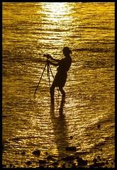 Photographer wetting his Tri-pod-1=