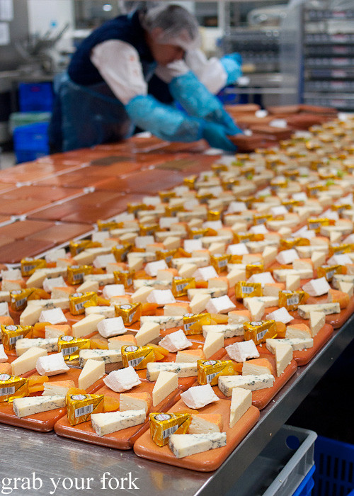 Assembling cheese platters during a behind-the-scenes tour of Emirates Flight Catering