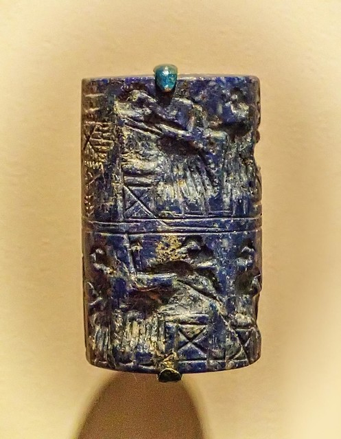 Closeup of lapis lazuli cylinder seal  recovered from the royal cemetery of Ur, Iraq 2550-2450 BCE