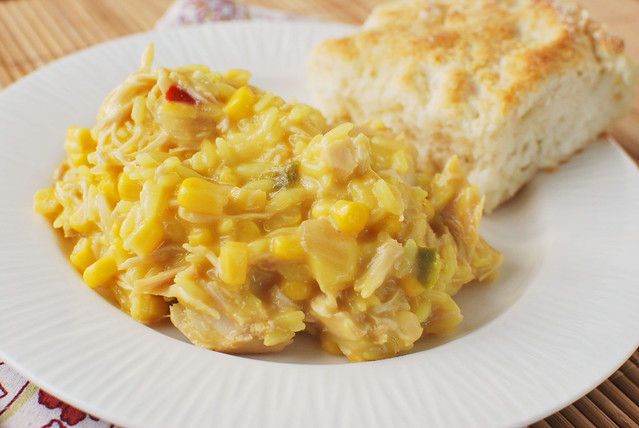 Slow Cooker Cheesy Chicken and Rice - total comfort food! Chicken, rice, and corn in a creamy cheesy sauce, cooked in the crockpot.