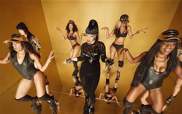 A still from Lily Allen's video shows her in the middle of a group of black dancers