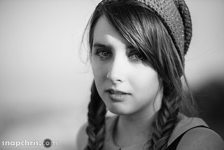 Pretty teen girl in braids seen in Black and white