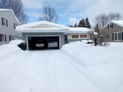 our home surrounded by snow