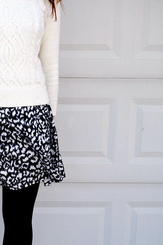 black and white skirt and white cable knit sweater