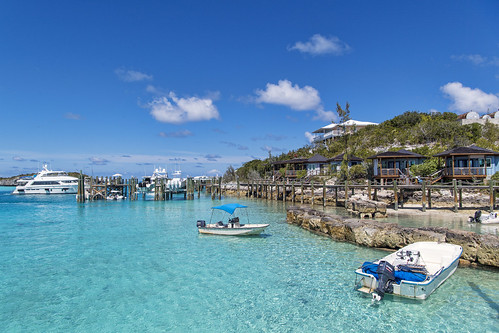 stanielcay cay landscape sea houses town sky clouds boats peer bahamas island vacation nikon d5