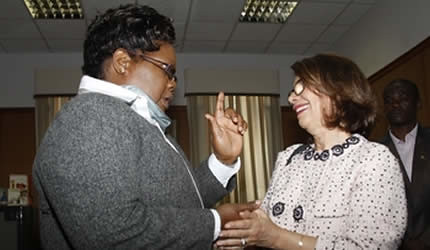 Acting President Joice Mujuru shows appreciation to Ms Stella Cohen for donating shoes and blankets to Mt Darwin West constituency at her Munhumutapa office in Harare on May 30, 2013. by Pan-African News Wire File Photos