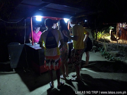 Checking the photos taken in Iwahig Firefly Watching in Puerto Princesa City, Palawan