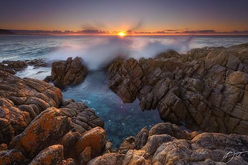 light seascape sunrise rocks tasmania lichen splash friendlybeaches