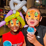 13-018 -- Terrion Darnell, age 7, and brother Steven Darnell, 8, show off their face paint, snow cones and balloons during the Titan Carnival: Family Zone.