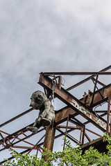 A toy ape hangs from the loading gantry
