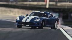 muscle car(0.0), race car(1.0), automobile(1.0), vehicle(1.0), performance car(1.0), automotive design(1.0), land vehicle(1.0), luxury vehicle(1.0), srt viper(1.0), supercar(1.0), sports car(1.0),