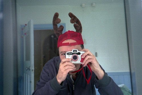 reflected self-portrait with Canon WP-1 camera and back-to-front antlers by pho-Tony
