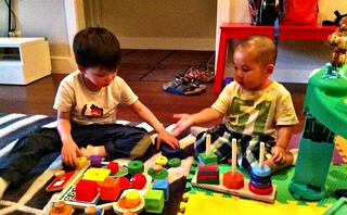 Cousins playing with blocks together