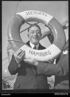 Count Felix Graf von Luckner holding a life belt on SEETEUFEL