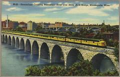 'Streamliner Crossing Mississippi River over Stone Arch Bridge, Minneapolis, Minn.' / postcard
