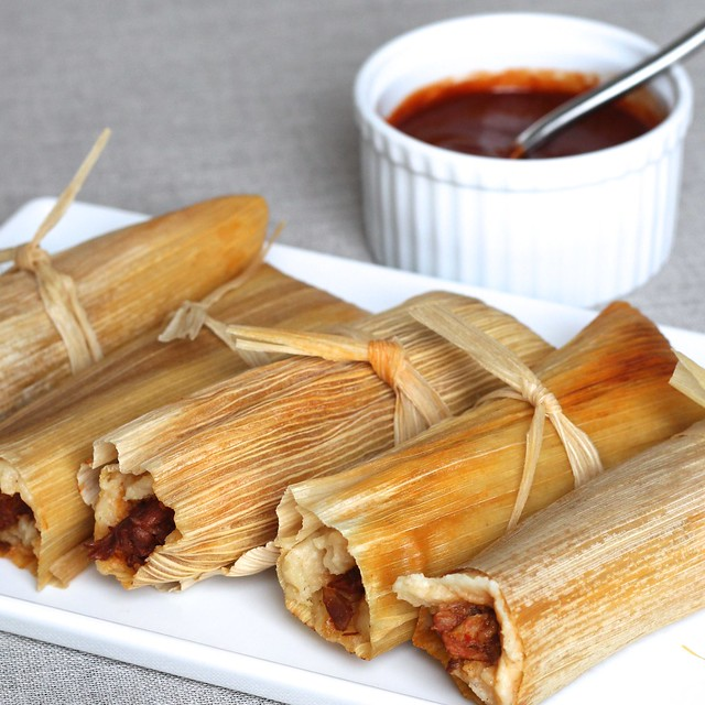 steamed tamales with salsa roja