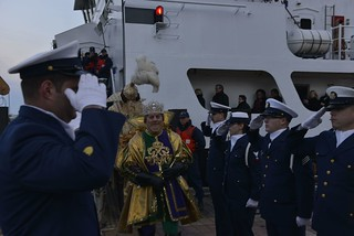 NEW ORLEANS - The Mardi Gras monarch King Rex and his krewe disembark the Coast Guard Cutter Harry Claiborne at Spanish Plaza in downtown to kick off the start of Lundi Gras, March 3, 2014. The 175-foot coastal construction tender delivered the Mardi Gras monarchs Kings Rex and Zulu to kick off the official start of Mardi Gras. U.S. Coast Guard photo by Petty Officer 1st Class Bill Colclough.