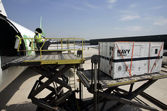 In this file photo, a Naval Sea Systems Command Supervisor of Salvage and Diving control van including U.S. Navy search equipment is loaded onto a transport aircraft. (U.S. Navy)