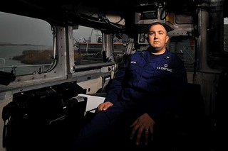 Petty Officer 1st Class Louis Keating, a member at Coast Guard Station Oregon Inlet, N.C., is shown sitting inside the cabin of a 47-foot Motor Life Boat at the station, Monday, March 18, 2014. Surfman are the most highly trained boat drivers in the Coast Guard. (U.S. Coast Guard photo by Petty Officer 1st Class Brandyn Hill)