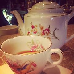 purple(0.0), cup(0.0), coffee cup(0.0), art(1.0), serveware(1.0), cup(1.0), tea(1.0), tableware(1.0), saucer(1.0), drink(1.0), ceramic(1.0), pink(1.0), porcelain(1.0),